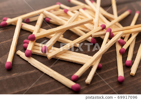 Matches on a white isolated background. Matches on a wooden background. Matches. 69917096