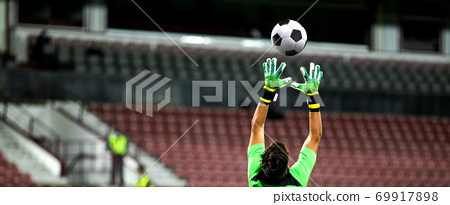 soccer game background goalkeeper catching football 69917898