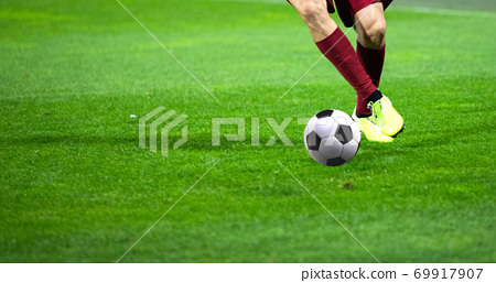 soccer game background player kicking football 69917907