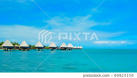 Tropical resort water cottage 69923150
