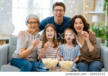 Happy family spending time together. 69926545