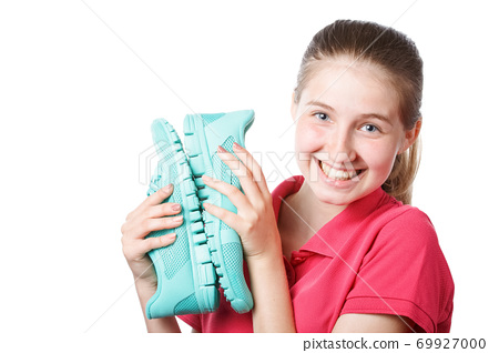 beautiful girl holds new sneakers in hands 69927000