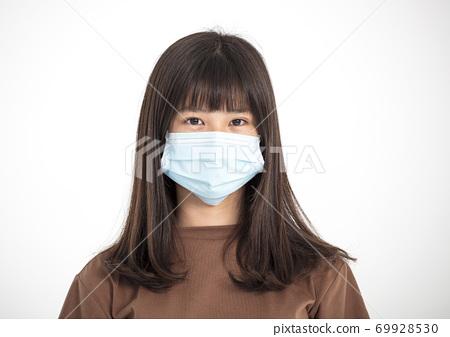 Asian teenager girl wearing medical face mask 69928530