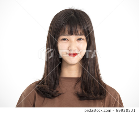 young happy teenager girl looking at camera 69928531