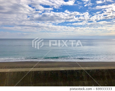 Sea, sand, blue sky and clouds seen from the beach 69933333