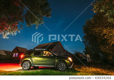 Suv dirty Car Parking On Street Under Night Starry Sky. Russian Village 69934268