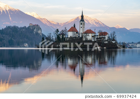 Bled lake panorama at sunset in winter 69937424