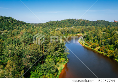 Gauja National Park. Green forest and river in Sigulda, Latvia 69937744