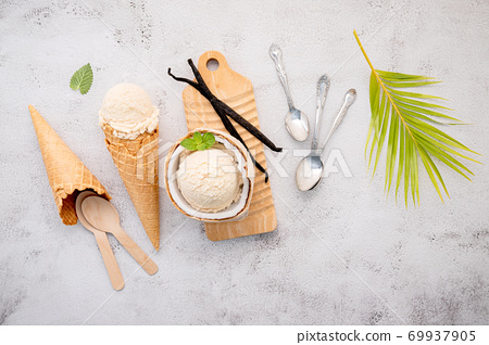 Coconut ice cream flavours in half of coconut setup on white stone background. Summer and Sweet menu concept. 69937905