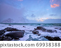 Coast of Norwegian sea on rocky coast in fjord on sunset 69938388
