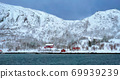 Red rorbu houses in Norway in winter 69939239
