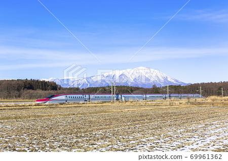 Mt. Iwate and Akita Shinkansen Komachi in winter, Shizukuishi Town, Iwate Prefecture 69961362