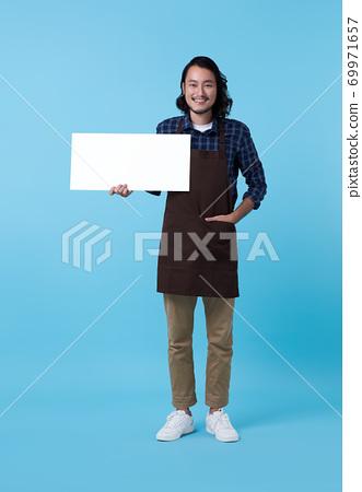 entrepreneur Asian man showing blank billboard 69971657