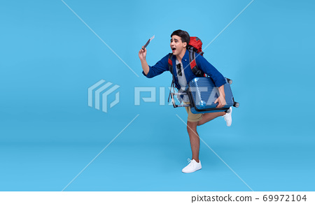 excited Asian man traveler running with backpack 69972104