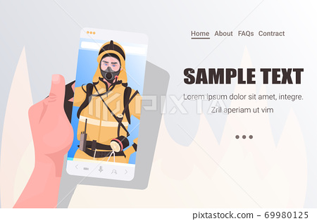 firefighter in uniform on smartphone screen self isolation online communication concept horizontal 69980125