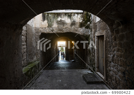 Passage from the church between the medieval houses on the island of Korcula, Croatia 69980422