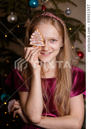 girl holding christmas gingerbread in hands 69981937