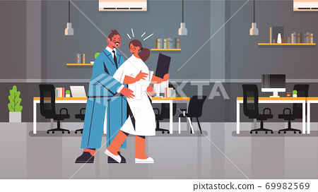 businessman molesting female employee sexual harassment at workplace businesswoman feeling disgusted office interior 69982569