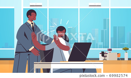 businessman molesting female employee sexual harassment at work concept lustful boss touching secretary's shoulders 69982574