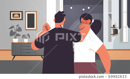 angry man punching and hitting woman stop domestic violence and aggression against women 69982633