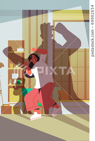 shadow of angry husband punching and hitting wife stop domestic violence and aggression against women 69982654