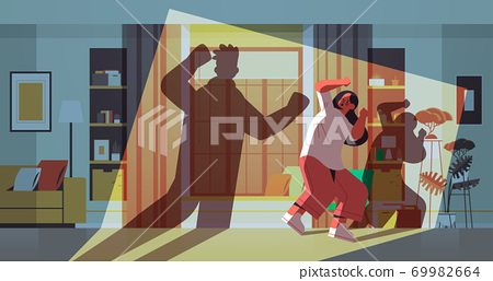 shadow of angry husband punching and hitting wife stop domestic violence and aggression against women 69982664
