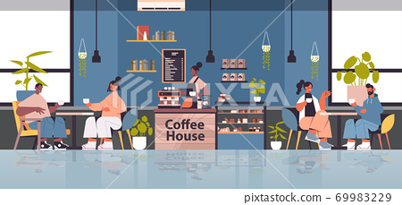 female barista in uniform working in coffee house waitress in apron making coffee for mix race clients 69983229