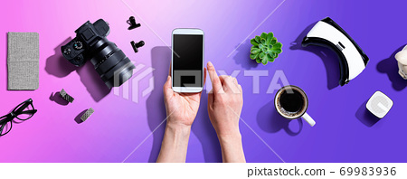 Person using a smartphone with a VR and a camera 69983936