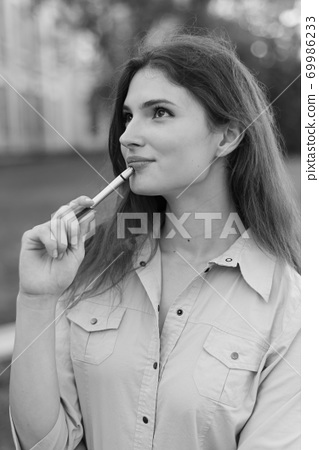 Young girl student with pen. Black and white photo. BW 69986233