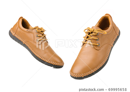 New brown men leather shoes. Studio shot isolated on white 69995658
