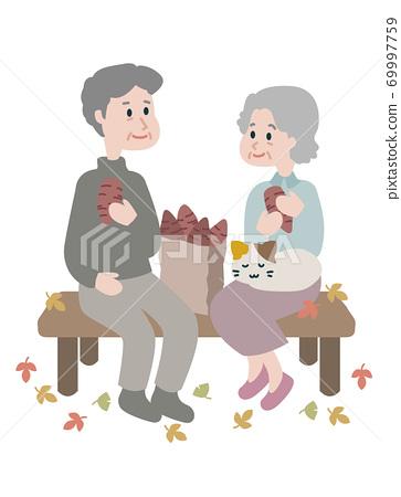 Elderly couple eating roasted sweet potato 69997759