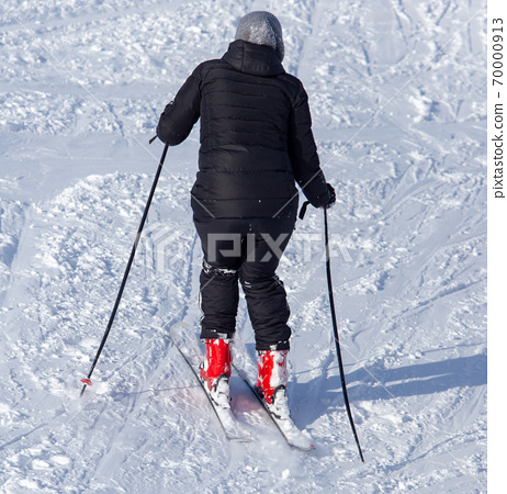 Girl skiing in the snow from the mountain 70000913
