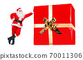 Cheerful Santa Claus stands by the large Christmas gift box, isolated on a white background.  70011306