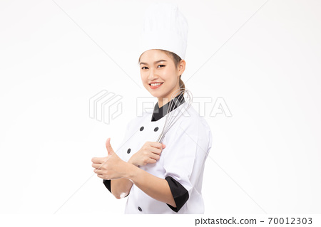 Beautiful Asian chef woman smile and holding Stainless balloon whisk isolated on white background,Happiness and Cheerful Professional chef Concept 70012303