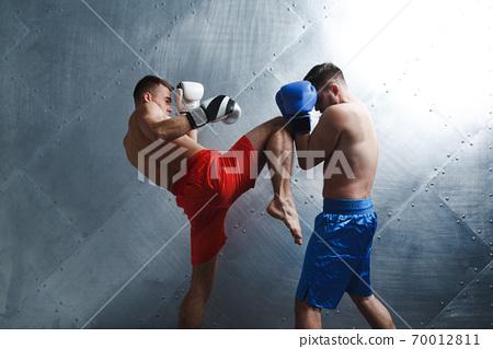 Two men boxers fighting muay thai boxing 70012811