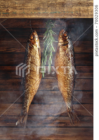 Delicious smoked herring with rosemary. 70029306