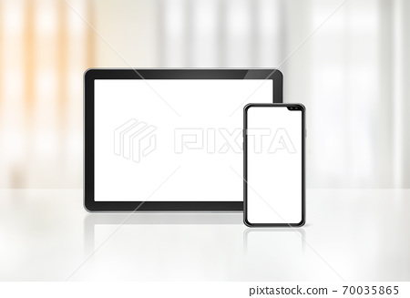 Mobile phone and digital tablet pc on office desk 70035865