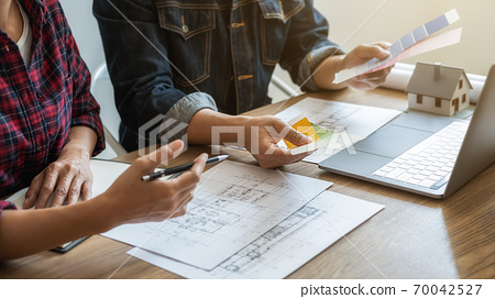 Interior and Architect choosing color in color swatch samples chart for house coloring selection. 70042527