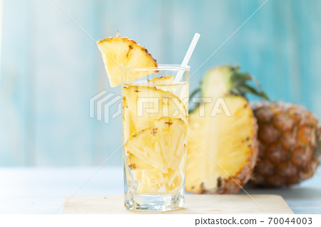 Pineapple Juice Pieces Pineapple Healthy Drink and summer fruit drink Concept 70044003