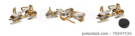 Set of old steel skates isolated on a white background Hockey puck 70047530