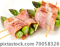 Skewed asparagus wrapped in bacon 70058326