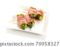 Skewed asparagus wrapped in bacon 70058327