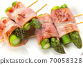 Skewed asparagus wrapped in bacon 70058328