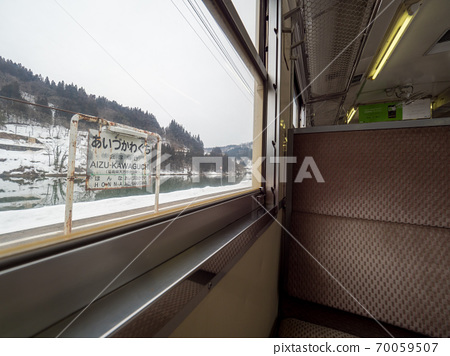 Scenery of the local line running in the snowy country Tadami Line 70059507