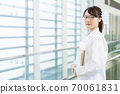 Female student in white coat, science student, medical student 70061831