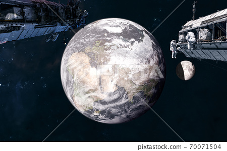 Space stations on background of Earth and the Moon in warm light of Sun. Solar system. 3D Render 70071504