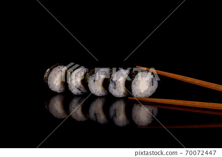 Fresh delicious beautiful sushi rolls on a dark background 70072447