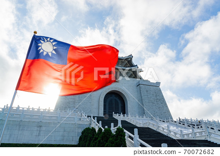 Morning sunny view of the National Chiang Kai-shek Memorial Hall with Taiwan flag swinging 70072682