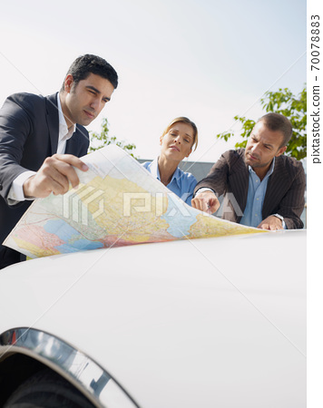 Business People Planning Car Trip Consulting Map For Directions 70078883