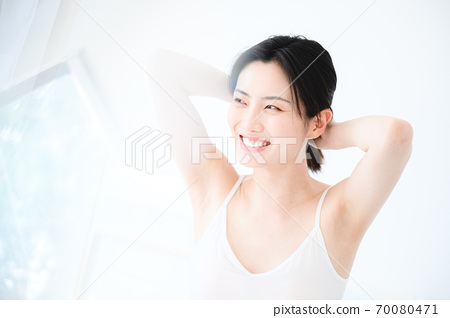 Young beautiful oriental young women at home daily 70080471